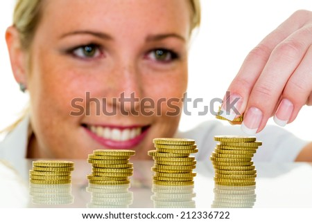 a woman stacked coins. save money for the future. - stock photo