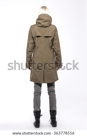 A woman stand up wearing grey denim(pants, trousers, jean) and black leather boots and brown jumper(coat, outer, hood) for winter and sports isolated white at the studio.  - stock photo