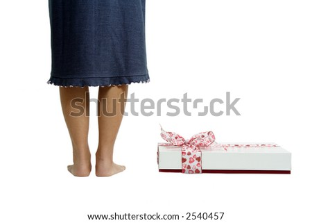 A woman standing next to a gift box