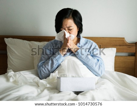 A woman suffering from cold