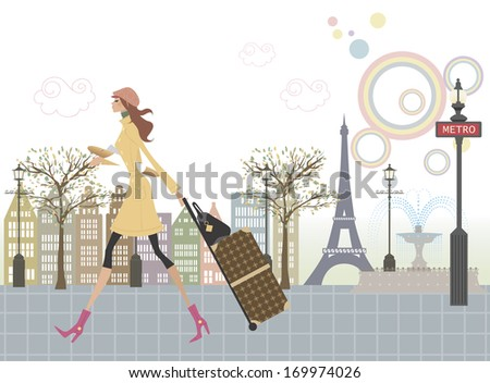 A woman taking a stroll past the metro with her luggage in hand. - stock photo