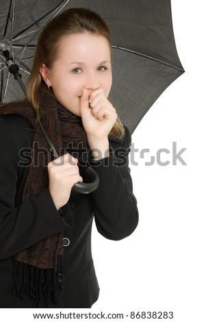 A woman under an umbrella on a white background. - stock photo