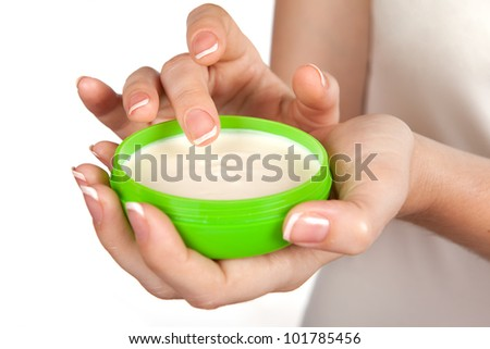 A woman uses the cream to your hands