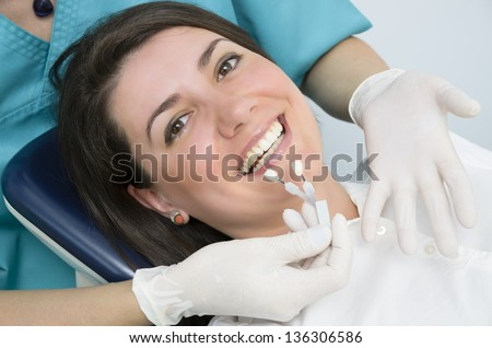A Woman visiting her dentist - stock photo