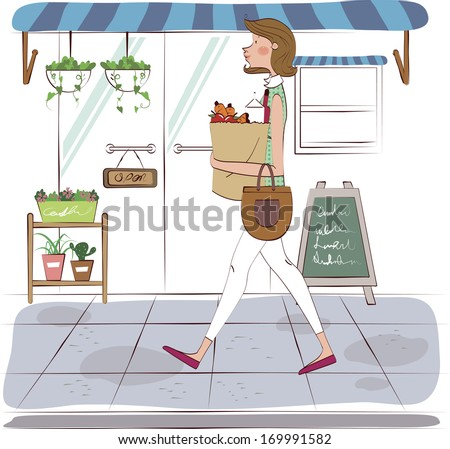 A woman walking home from the grocery store. - stock photo