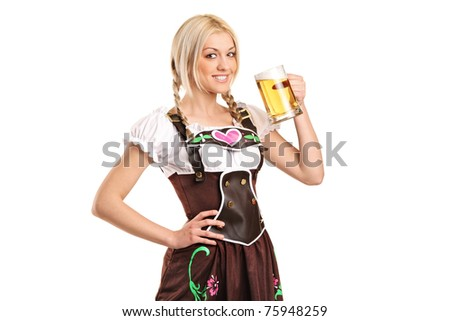 A woman wearing a traditional costume and holding a beer glass isolated on white background