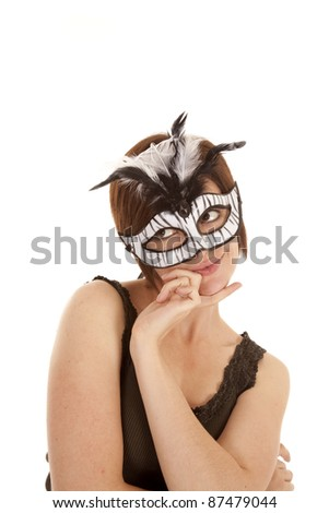 A woman wearing a white mask with a shy expression on her face. - stock photo