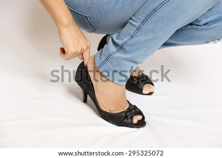 A woman wearing black high heels. - stock photo