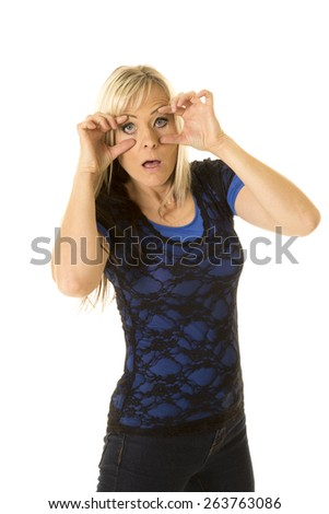 a woman who is tired, trying to keep her eyes open. - stock photo