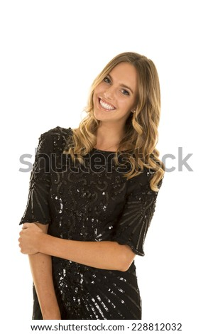 A woman with a big smile on her face, in her fancy dress. - stock photo