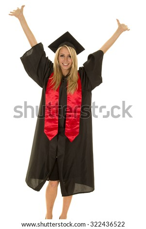 A woman with a big smile on her face with her arms raised high graduating. - stock photo