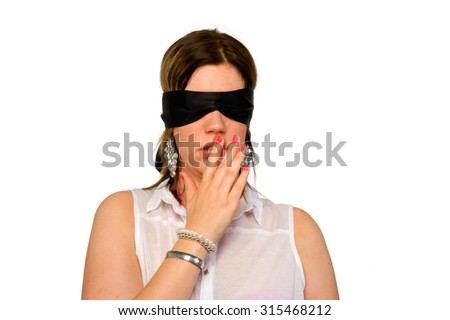 A woman with a blindfold for her eyes - stock photo