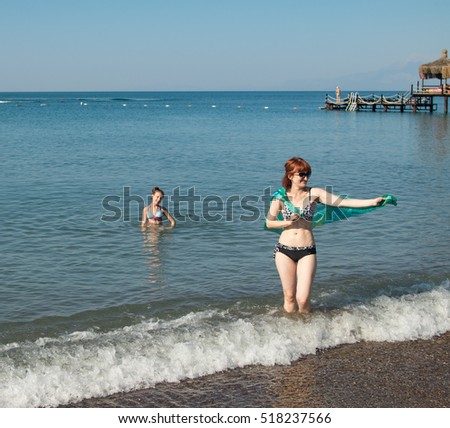a woman with a child on the beach, sea, summer