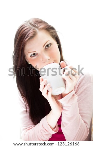 A woman with a cup enjoys drink - stock photo