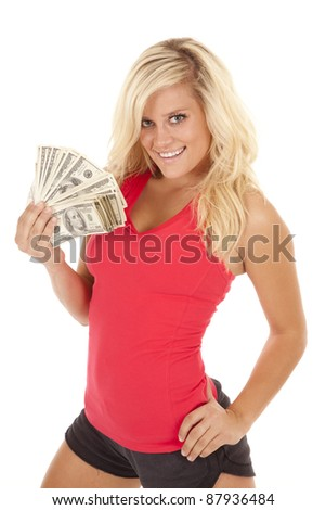 A woman with a fan of one hundred dollar bills in her hand with  a smile on her face. - stock photo