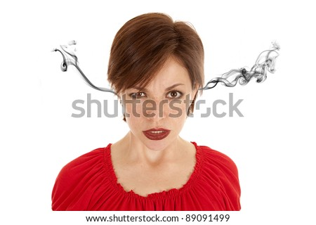 A woman with a frustrated and angry expression on her face. - stock photo