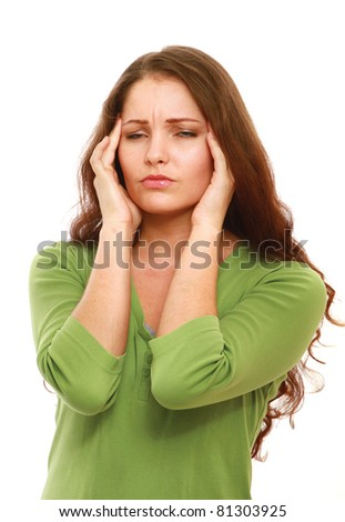 A woman with a headache holding her hand to the head - isolated on white