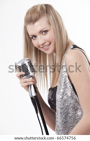 A woman with a microphone - stock photo