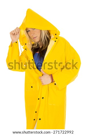 a woman with a serious expression on her face, with the hood of her jacket hiding her face. - stock photo