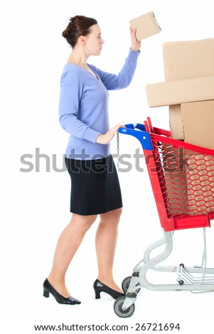 A woman with a shopping trolley full of goods on white