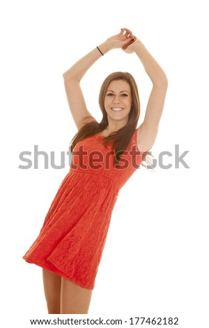 a woman with a smile on her face and her arms up spinning. - stock photo