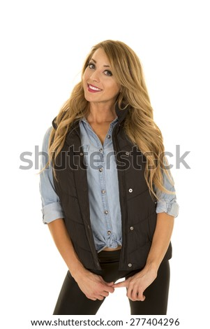 A woman with a smile on her face, tilting her head with a playful expression. - stock photo
