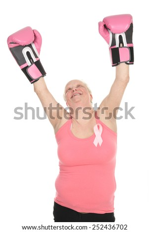 A Woman with boxing gloves ready to fight. - stock photo
