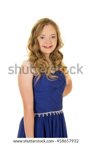 a woman with down syndrome in her blue fancy dress with a smile on her face.