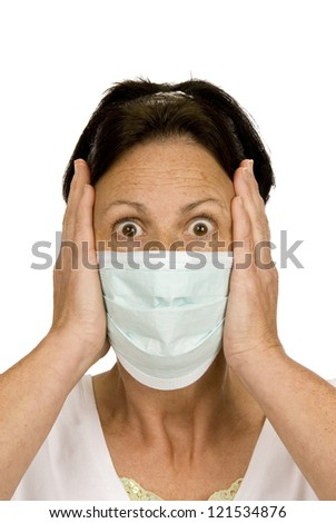 A woman with her hands on each side of her face being very scared and concerned of catching germs.