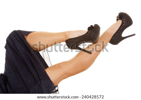 a woman with her legs out in the air in her blue dress. - stock photo