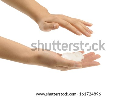 A woman with suds on one palm. - stock photo