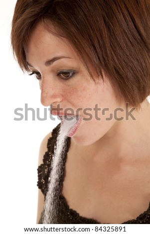 A woman with sugar pouring out of her mouth.