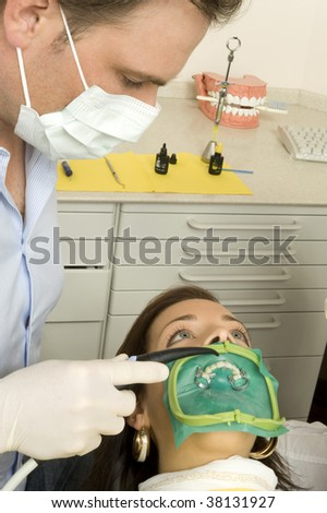A woman with the dentist - stock photo