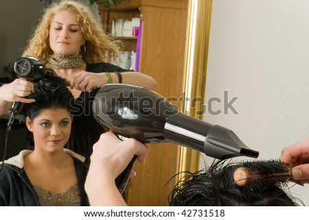 A woman with the hairdresser