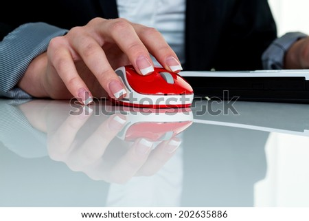 a woman working in an office and h���¤t the mouse of a computer in your hand. - stock photo