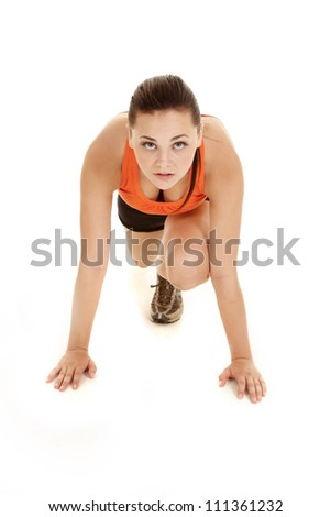 A woman working out in a runners stretch. - stock photo