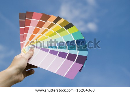 A women holding some colour guides. - stock photo