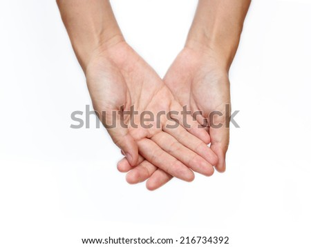 A women holds a handful, hands together.