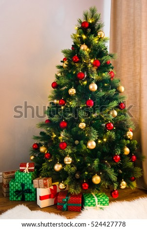 A Wonderful Christmas Tree Decorated With Traditional Red And Yellow Toys Many Gifts Under The