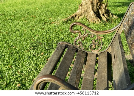 A Wood Bench with Alloy frame in the Public Park  - stock photo