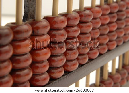 A wooden abacus in a studio shot, isolated on white. - stock photo