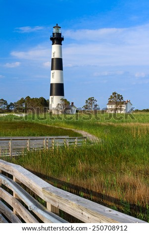 A wooden boardwalk leads to Bodie Island Lighthouse and keepers station at Cape Hatteras National Seashore on North Carolina's Outer Banks.