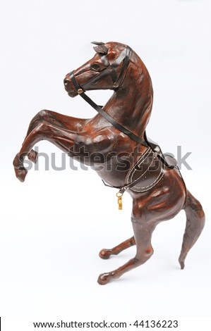 A wooden brown horse isolated on white - stock photo