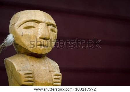 A wooden carving featuring the Cook Islands ancestral figure known as Tangaroa - stock photo
