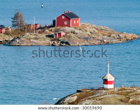 A wooden cottage in archipelago in Finland - stock photo