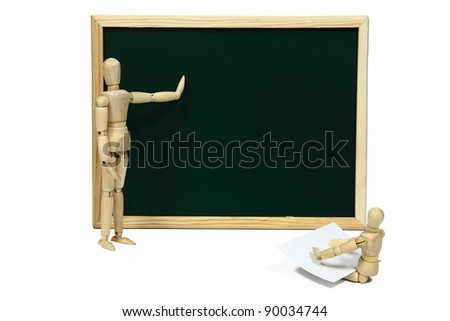 A wooden doll teacher teaching something to a pupil using a blackboard  isolated on white - stock photo