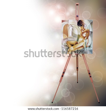 A wooden easel with a painting - stock photo