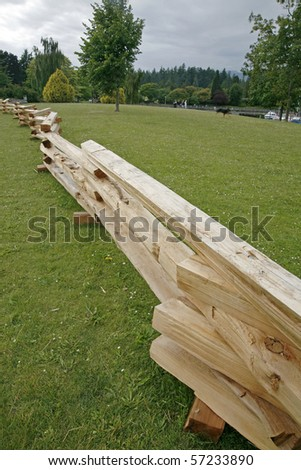 A wooden fence in the park with vertical view. - stock photo