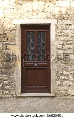 A wooden front door - stock photo