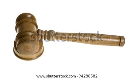 A wooden gavel rests on top of the strike plate isolated on white - stock photo